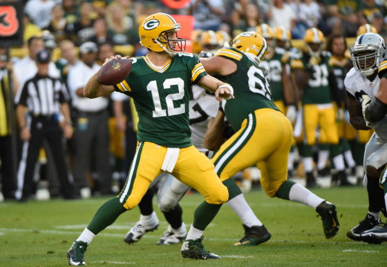 Aug 22, 2014; Green Bay, WI, USA; Green Bay Packers quarterback Aaron Rodgers (12) during the game against the Oakland Raiders at Lambeau Field. Mandatory Credit: Benny Sieu-USA TODAY Sports
